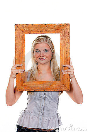 Woman looking through a picture frame