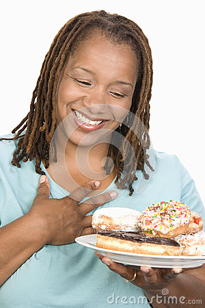Woman Looking Plate Of Donuts