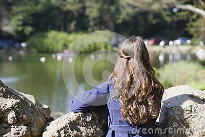 Woman Looking at Pond