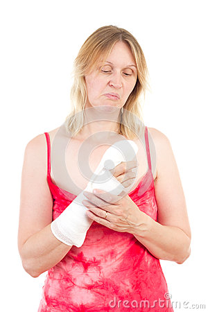 Woman looking sad at her bandaged finger