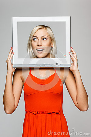 Woman looking through screen frame