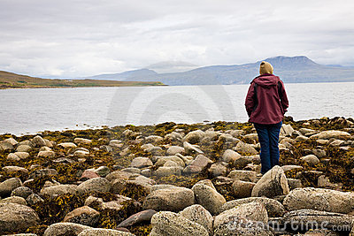 Woman looking at sea, Scotland