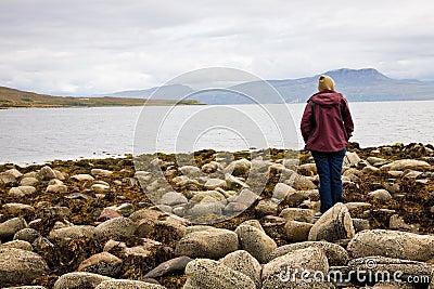 Woman looking at sea, Scotland