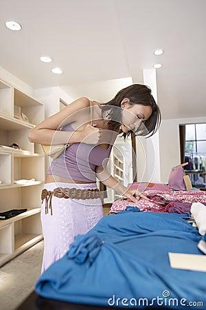 Woman Looking at Shirt