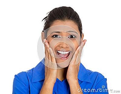 Woman looking shocked surprised, hands on cheeks