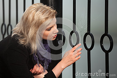 Woman looking at the spider web