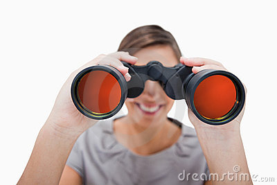Woman looking through spyglasses