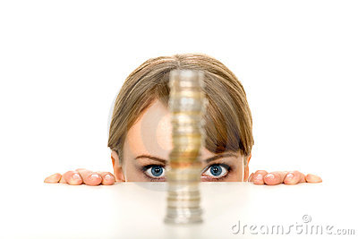 Woman looking at stack of coins