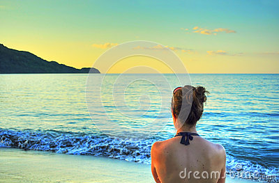 Woman looking at sunset on beach
