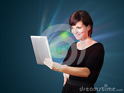 Woman looking at tablet with abstract lights