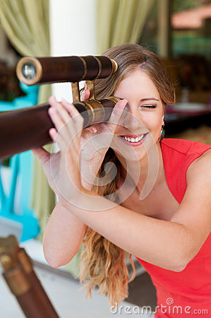 Woman looking through the telescope