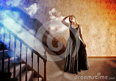 Woman Looking Up at Bright Light of Hope