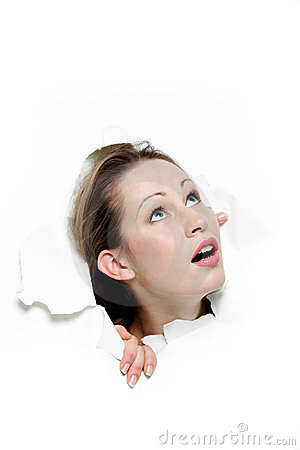 Woman looking up through hole in paper
