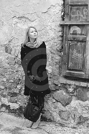 Woman looking  waiting near the retro wall