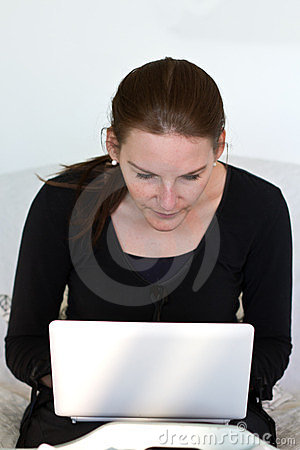 Woman Looking At White Netbook