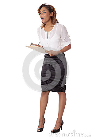 Woman looks amazed while taking down notes.
