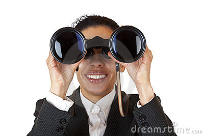 Woman looks through binoculars and found business
