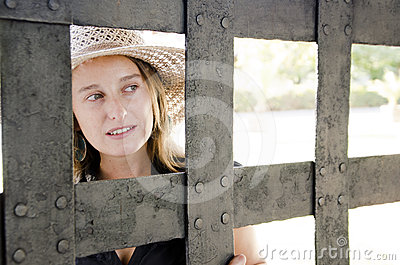Woman looks through the gate