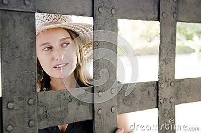 Woman looks through the gate