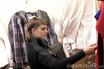 Woman looks at jacket