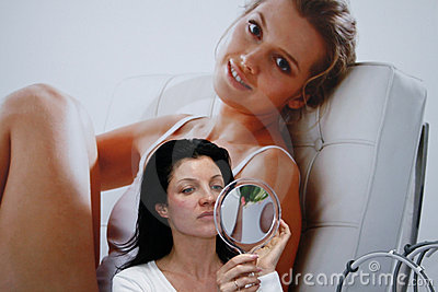 Woman looks in the mirror Editorial Stock Image