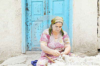 Woman loosening wool
