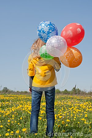 Woman with lots of balloons