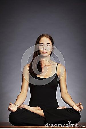 Woman in lotus posture (Padmasana)