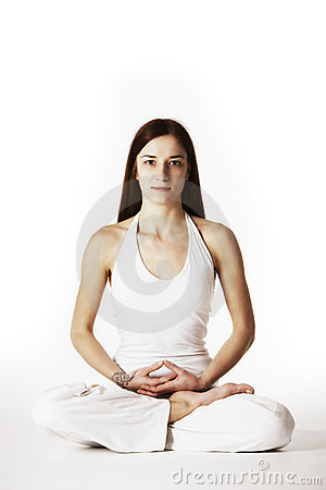 Woman in lotus Yoga posture (Padmasana)