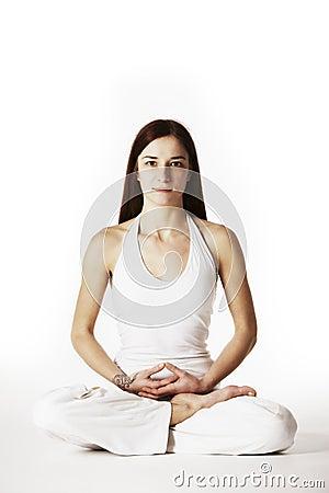 Woman in lotus Yoga posture (Padmasana)