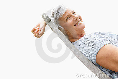 Woman with a lovely smile relaxing on chair