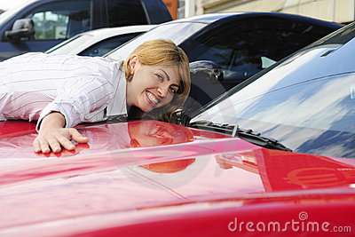 Woman loves her  new sports car