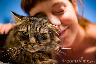Woman loving her pet cat