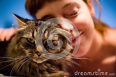 Woman loving her pet cat