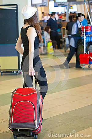 A woman with luggage in the airport