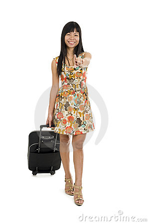Woman with luggage pointing with finger