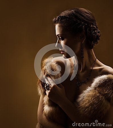 Woman in luxury fur coat. Vintage style.