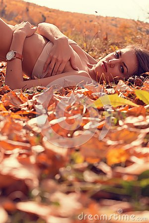 Woman lying in Autumn forest