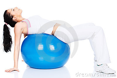 Woman lying on back on the pilates ball