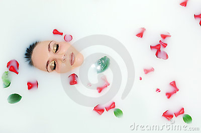 Woman lying in bath