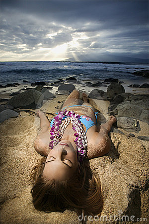 Woman lying on beach.