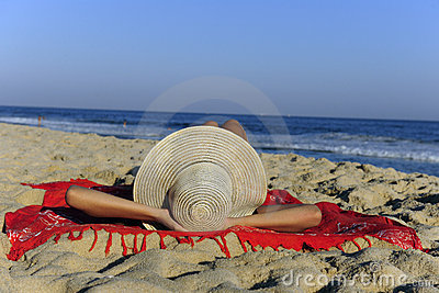 Woman lying on the beach relaxing