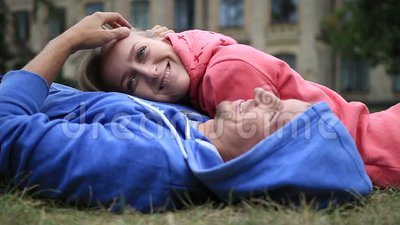 Woman lying on the chest of her beloved outdoors stock footage