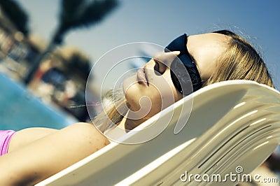 Woman lying on a deckchair