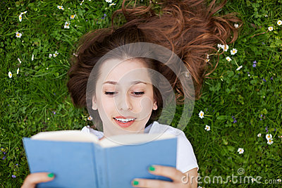 Woman lying down with book
