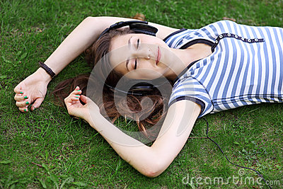 Woman lying on grass