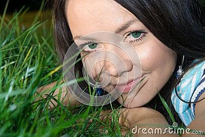 Woman lying at grass