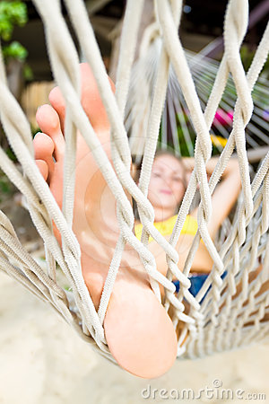 Woman lying on a hammock