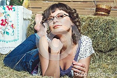 Woman lying on hay