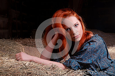 Woman lying on a haystack